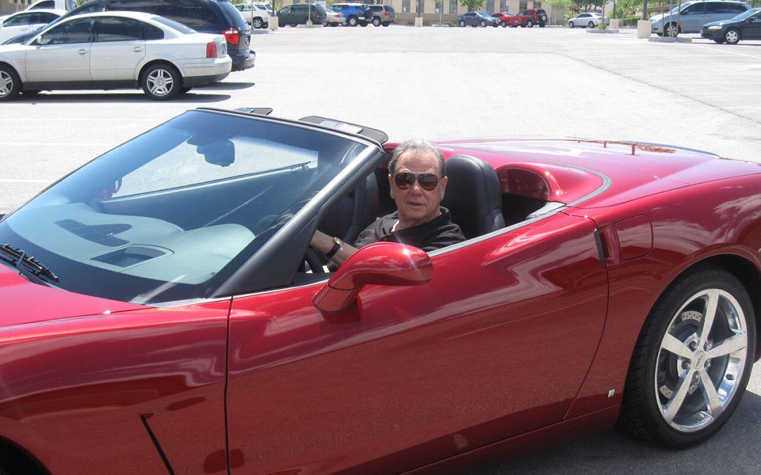 LivOn founder Les Nachman in a red convertible corvette