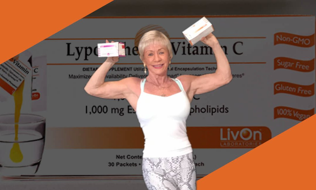 Iris Davis posing with cartons of LivOn products