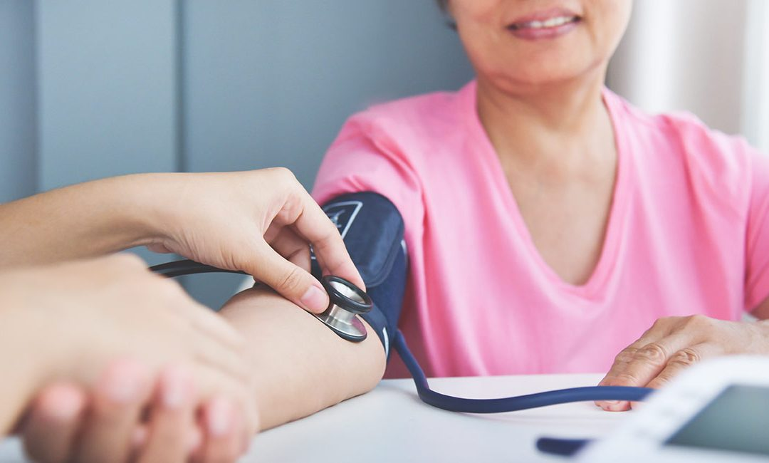 woman getting blood pressure measured
