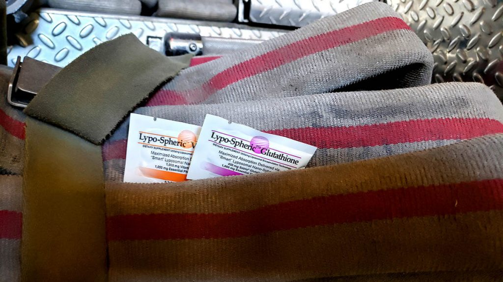 Lypo-Spheric® Glutathione and Vitamin C packets with a fire hose