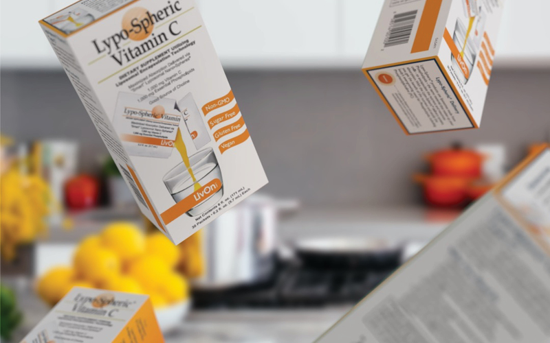 lypo-spheric vitamin c cartons flying through the air in the kitchen